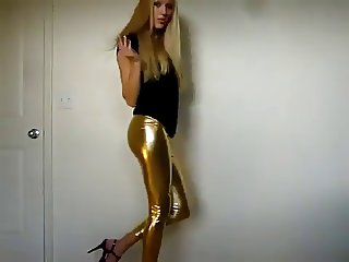 Stunning blonde teasing in gold latex