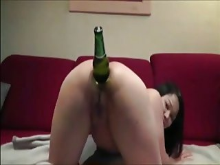 Asian girl plays with a bottle