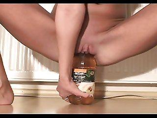 Skinny girl rides a bottle