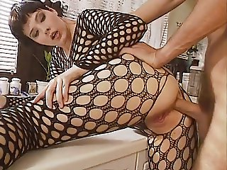 Bodystocking anal in kitchen