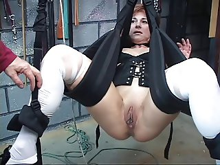 Cute mature redhead gets her pussy toyed with in a sex swing