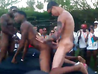 Public interracial sex on bed