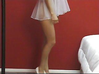 Sweet brunette strips her sheer white negligee