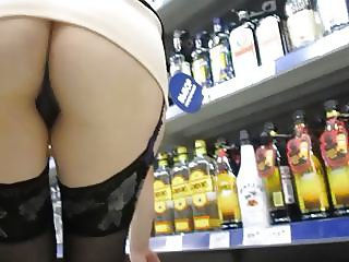 Girl flashing stockings and pussy in a liquor store
