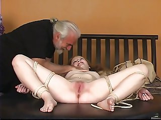 Dude binds rosy titted blonde 039 s legs open then fingers her clit