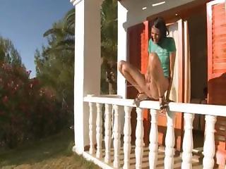 brunett peeing off the porch