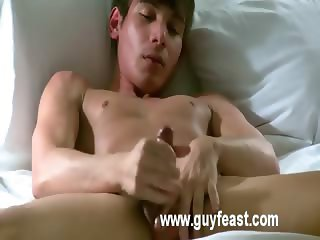 Angel s been in a pair videos with other boys but this time it s just his cute self with his penis in hand