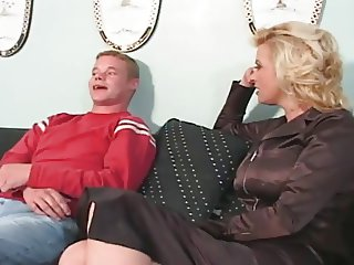 Blonde MILF with big boobs fucking younger cock