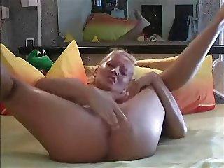 Blonde masturbates. toys huge dildo